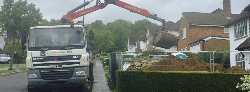 Grab lorry clearing muck away from construction site
